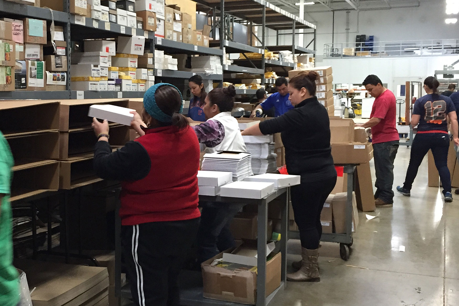 Workers Assemble Sales Kits